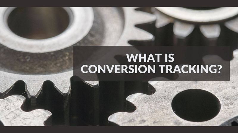 Metal interlocked gears, text What is conversion tracking?