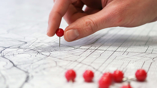 Map with red pins being placed
