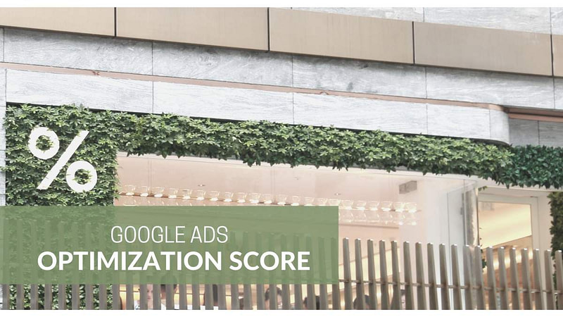 % Sign on vines growing on a house. Text Google Ads Optimization Score