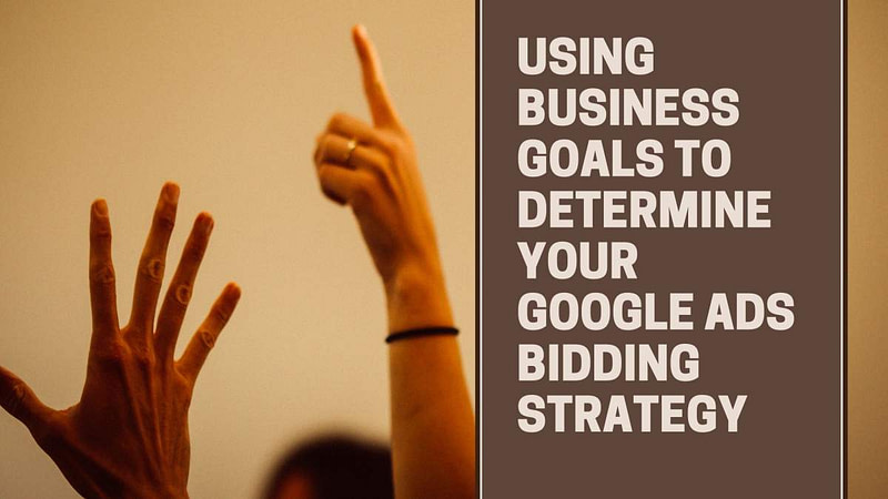 Hands up in air, text Using BusinessGoals To Determine Your Google Ads Bidding Strategy