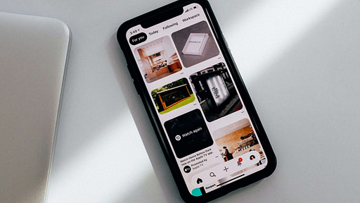 Phone open with Pinterest feed including a video ad