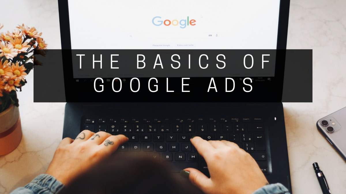Google search being done on laptop, hands typing, text The Basics of Google Ads