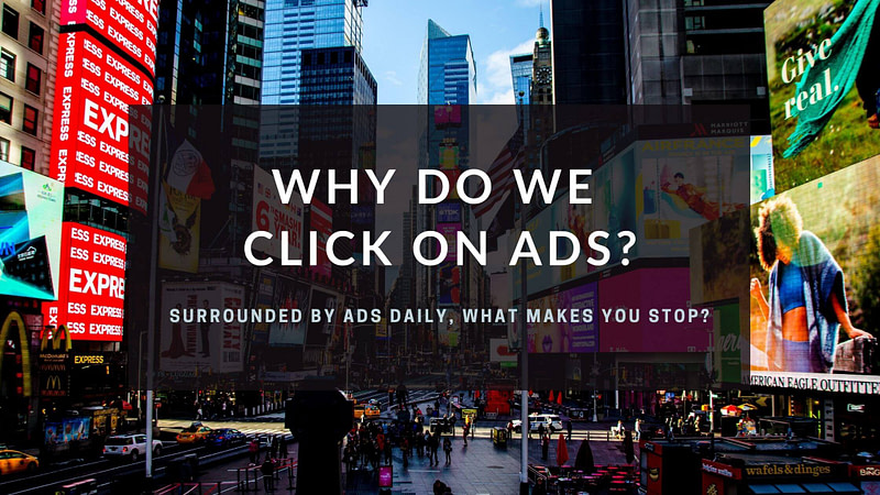 Times Square with text Why do we click on ads?